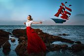 pic of sailfish  - Beautiful girl holding a kite on sea background - JPG