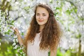 Cute Smiling Girl Outdoors, Sunny Spring Portrait Young Girl, Curly Hair, Good Open Look