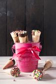 pic of bonbon  - Mini ice creams with bonbon in pink basketselective focus - JPG