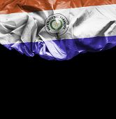 Paraguay waving flag on black background