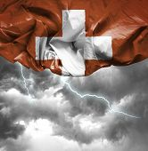 Switzerland waving flag on a bad day