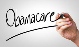 stock photo of lobbyist  - Obamacare hand writing with a black mark on a transparent board - JPG