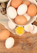picture of chicken-wire  - Eggs and whisk on wooden table - JPG