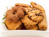 stock photo of biscuits  - Variety of biscuits in a plate on white background - JPG