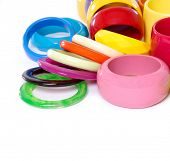 foto of bangles  - Pile of round modern colorful plastic bangles - JPG