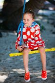 picture of tire swing  - Adorable little girl having fun on swing on summer day - JPG