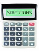 stock photo of macroeconomics  - Calculator with SANCTIONS on display isolated on white background - JPG