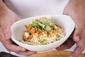 stock photo of noodles  - Chef present egg Noodle with roast chicken  - JPG
