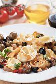 stock photo of italian parsley  - Italian tortellini pasta salad with parsley and green olives - JPG