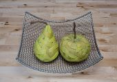 pic of baste  - Green pear and apple made from bast fibre in the silver basket - JPG