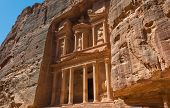 stock photo of treasury  - The Treasury of the Pharaoh building carved into the rock face at Petra in Jordan - JPG