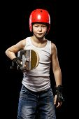 picture of attitude boy  - Boy with red hair with skateboard and helmet on a black background - JPG