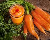 picture of orange-juice  - Fresh carrot juice glass with fresh organic carrots on wooden table - JPG