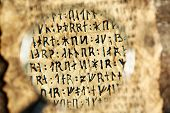 picture of hieroglyph  - Grunge paper with hieroglyphics with magnifier close up - JPG