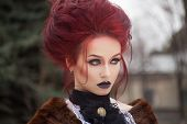 picture of gothic female  - sexy woman with gothic makeup and red hair and castle - JPG