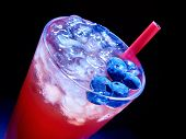 stock photo of tumbler  - Cold red blueberry drink  with a lot of berry  - JPG