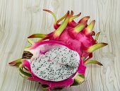stock photo of dragon fruit  - Asian Dragon fruit on the wooden background - JPG