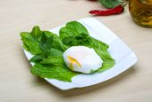 foto of benediction  - Egg benedict with salasd leaves on the wood background - JPG