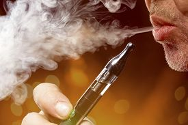 image of smoke  - close up portrait of a man smoking an e - JPG