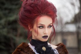 picture of gothic girl  - sexy woman with gothic makeup and red hair and castle - JPG