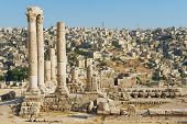 foto of amman  - View to the ancient stone columns at the Citadel of Amman with the Amman city at the background in Amman Jordan - JPG