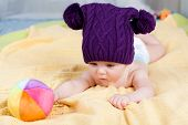 picture of little boys only  - Cute little boy plaing with ball on soft textile - JPG