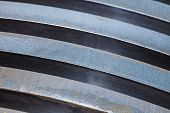 picture of ferrous metal  - Background of steel plates stacked in warehouse - JPG