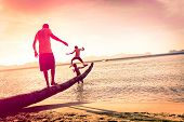 foto of marsala  - Father playing with sons at tropical beach with tilted horizon  - JPG