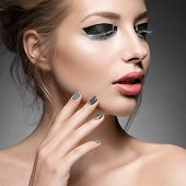 image of nail-design  - Beautiful girl with bright creative fashion makeup and Grey nail polish - JPG