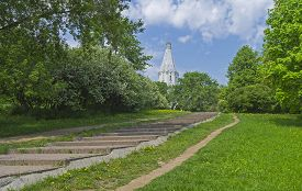 stock photo of ascension  - The path to the white stone Orthodox church on a hillside - JPG