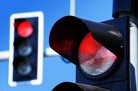 stock photo of traffic signal  - Traffic lights over blue sky - JPG