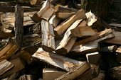 image of cleaving  - A stack of cleaved wood firewood pile of firewood - JPG