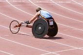 image of physically handicapped  - A physically handicapped athlete on the running track in a specially constructed wheelchair