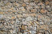 Natural stack of ocean worn hole pocked rocks