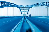 stock photo of girder  - road through the bridge with blue sky background of a city - JPG