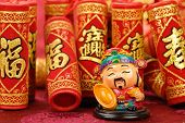 Chinese lunar new year decoration--Chinese traditional mammon figure and firecrackers.