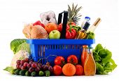 Plastic Shopping Basket With Assorted Grocery Products poster