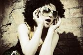 Fashion art photo. The beautiful young girl. Retro styled photo