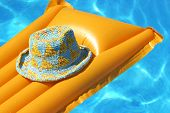 Hat On Yellow Airbed
