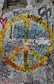 stock photo of tyranny  - Symbolic graffiti on the last remnants of the Berlin wall in Germany - JPG