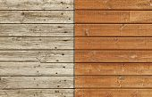 Old and weathered wooden wall against a brand new and varnished wall poster
