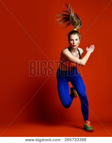 poster of Runner Woman Isolated. Running Fit Fitness Sport Model With Long Hair In Pony Tail In Blue Pants Gym