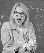Woman Teacher Holds Crumpled Pieces Of Paper. Fed Up Of Fails. Trial And Error Is Fundamental Method poster