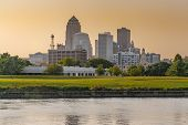 City Skyline Of Des Moines, Iowa Across The Racoon River At Sunset poster