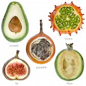 half fresh fruits with names  ( kiwano , avocado, feijoa, granadilla, fig ) isolated on white backgr