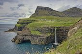 Steep Green Hills In The Faroe Islands