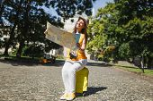 Joyful Traveler Tourist Woman In Casual Clothes Hat Sitting On Suitcase Looking On City Map Search R poster
