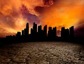 image of post-apocalypse  - City overlooking desolate desert landscape with cracked earth - JPG