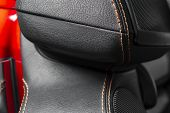 Modern Luxury Car Black Leather Interior. Part Of Leather Car Seat Details With Red Stitching. Inter poster