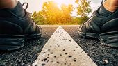 Running Shoes, Athlete Running Sport Feet On Asphalt Road With Straight White Line And Sunset Backgr poster